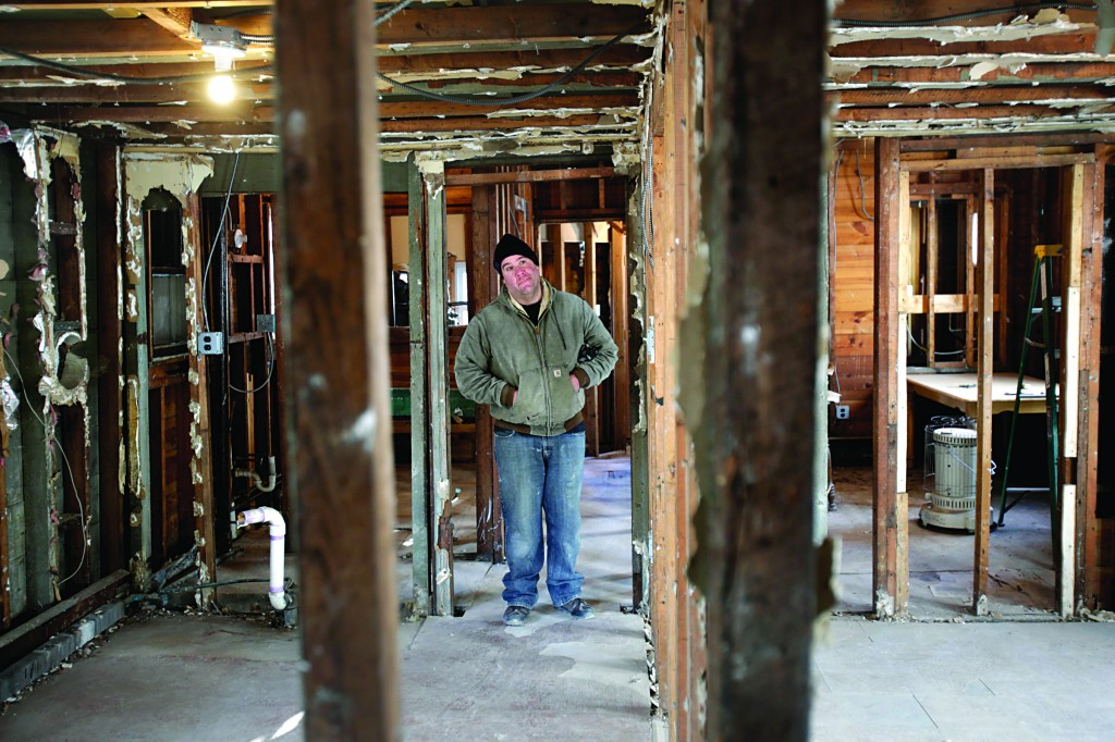 James Ferchland looks around his house, which was severely damaged by Superstorm Sandy, in the Broad Channel section of Queens, New York. (AP Photo/Seth Wenig)