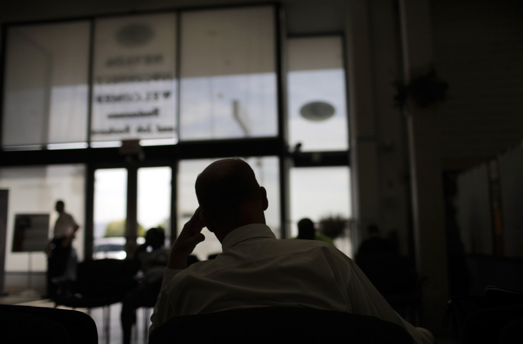 Jerald Vance, 50, is silhouetted as he waits to talk to a job counselor at a Nevada Jobconnect Career Center in Las Vegas. An Associated Press investigation released in January 2013 found that millions of mid-skill, mid-pay jobs have disappeared over the past five years and have been replaced with technology. (AP Photo/Jae C. Hong, File)