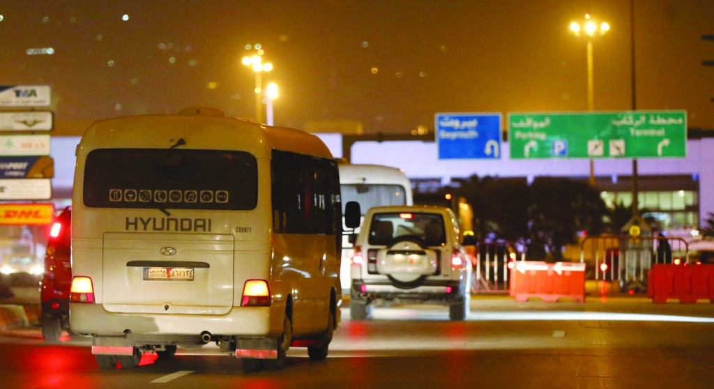 Russian nationals evacuated from Damascus arrive in a convoy at Beirut international airport. (REUTERS/ Mohamed Azakir)