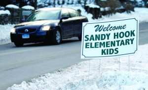 A sign is seen along the route to the Chalk Hill School where the Sandy Hook Elementary School children will begin to attend classes in Monroe, Connecticut, Wednesday. (REUTERS/Carlo Allegri)