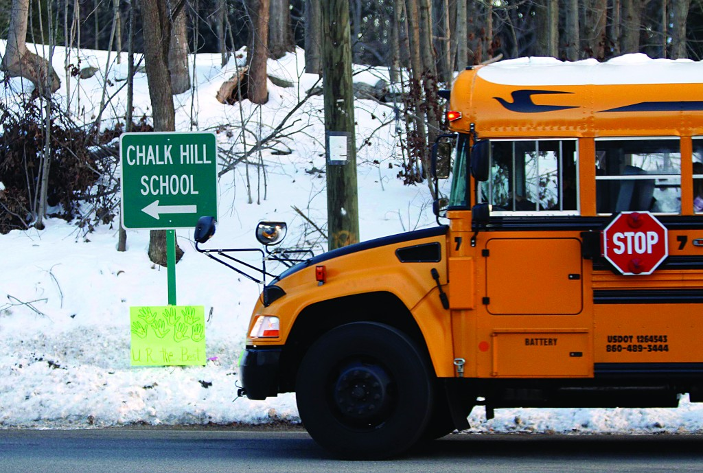 A school bus drives toward Chalk Hill School where the Sandy Hook Elementary School children will begin to attend classes in Monroe, Connecticut, Wednesday. (REUTERS/Carlo Allegri)