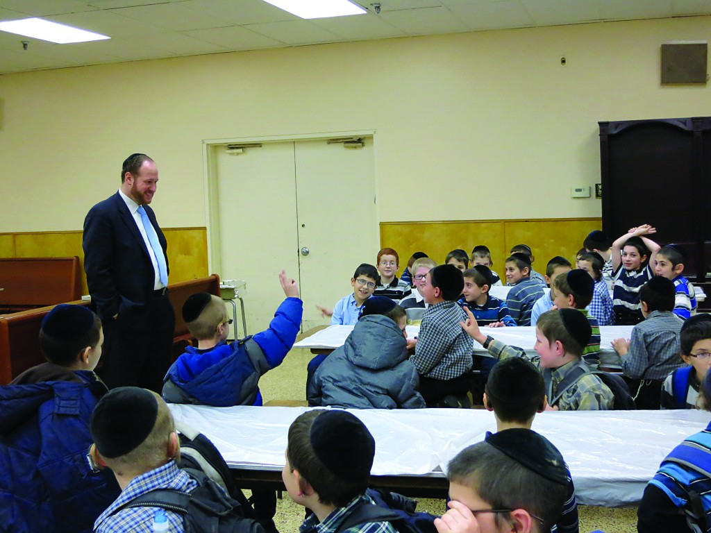Councilman David G. Greenfield discusses the role of local government during a pizza party he held for third graders at Tiferes Elimelech in Boro Park. The visit was part of Councilman Greenfield's efforts to introduce local students to civics and politics. He also recently visited Magen David Yeshiva's small business management class.
