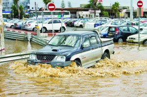 A vehicle drives through flood waters in the coastal city of Netanya, north of Tel Aviv. (JACK GUEZ/AFP/Getty Images)