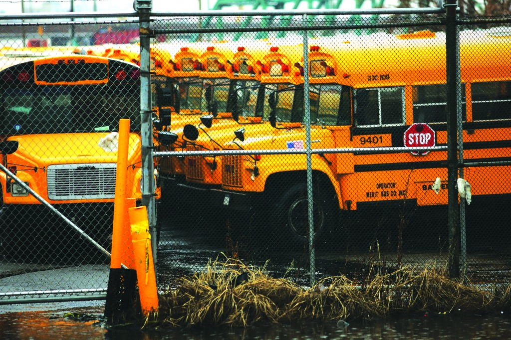 Idled school buses are viewed at the Atlantic Express Transportation Corp. after more than 8,000 New York City school bus drivers and aides went on strike over job protection. (Spencer Platt/Getty Images)