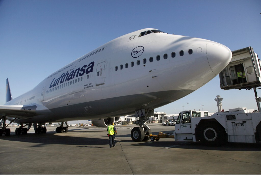 In this Monday, Dec. 10 photo, Lufthansa's Boeing 747-8 Brandenburg aircraft arrives at Los Angeles International Airport, after its inaugural passenger flight from Frankfurt, Germany to Los Angeles. Boeing Co. said on Thursday, Jan. 3, that it delivered 601 planes last year, putting it on track to beat European rival Airbus as the top plane maker for the year. (AP Photo/Nick Ut, File)