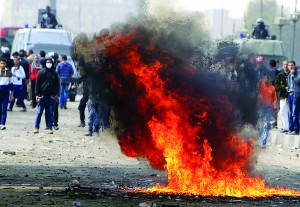 Fire burns from a Molotov cocktail thrown at riot police by protesters opposing Egyptian President Mohammed Morsi during clashes along Qasr Al Nil Bridge, which leads to Tahrir Square in Cairo, Sunday. (REUTERS/Mohamed Abd El Ghany)