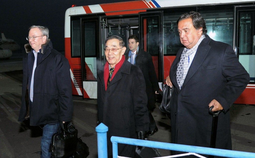 Eric Schmidt, executive chairman of Google (L) and former New Mexico Gov. Bill Richardson (R) arrive at an airport in Pyongyang, North Korea, Monday. (AP Photo/Kyodo News)