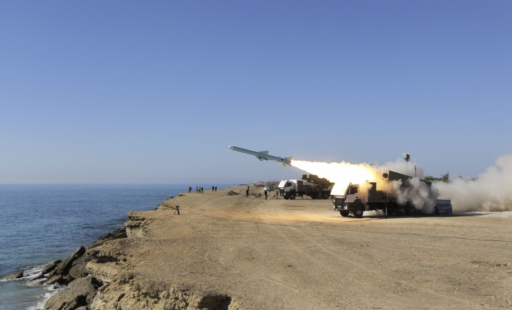 A Ghader missile is launched from the area near the Iranian port of Jask port on the shore of the Gulf of Oman during an Iranian navy drill, Tuesday. Iran says it has tested advanced anti-ship missiles in the final day of a naval drill near the strategic Strait of Hormuz, the passageway for one-fifth of the world's oil supply. (AP Photo/Jamejam Online, Azin Haghighi)