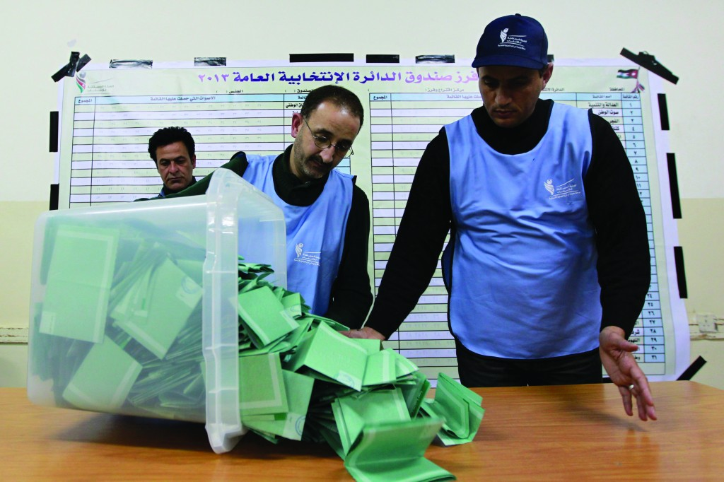 Officials count ballots after polls closed at a polling station in Amman Wednesday. (REUTERS/Muhammad Hammad)