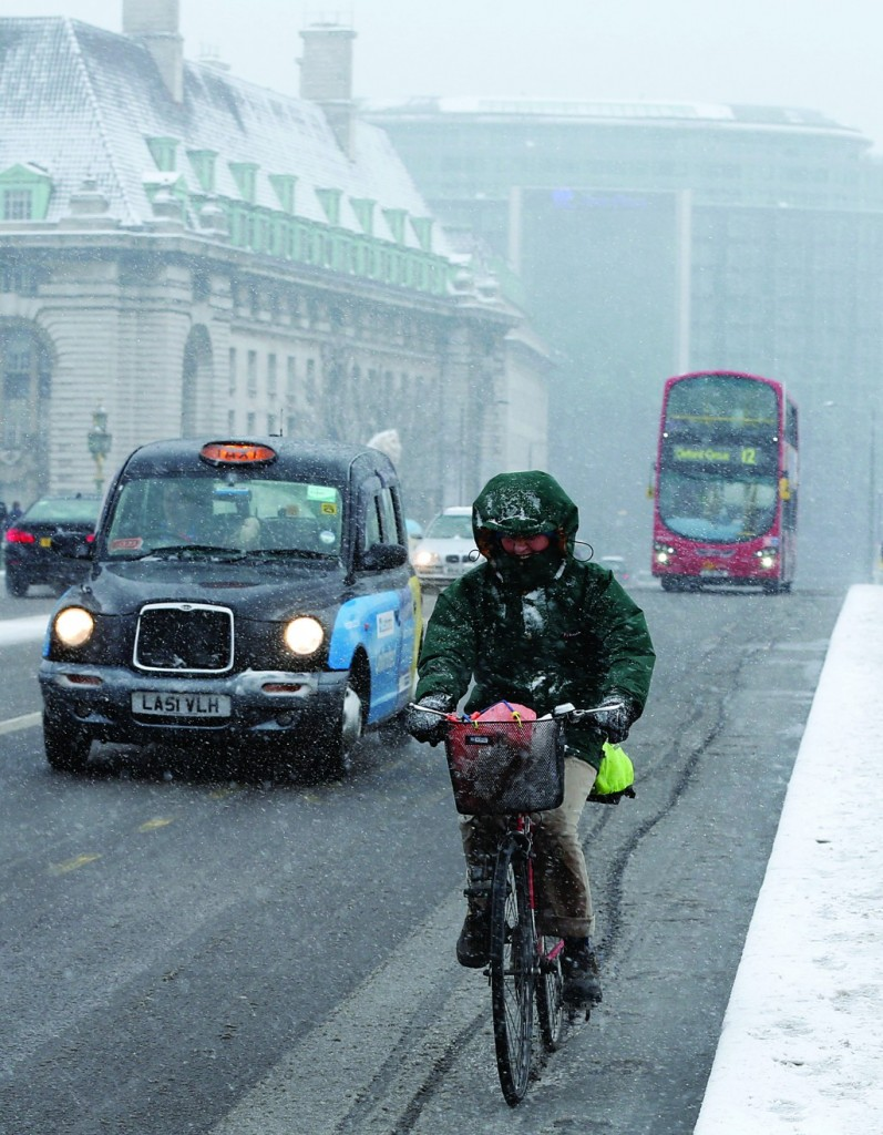 A cyclist crosses Westminster Bridge in the snow in central London on January 20. (Reuters/Olivia Harris)