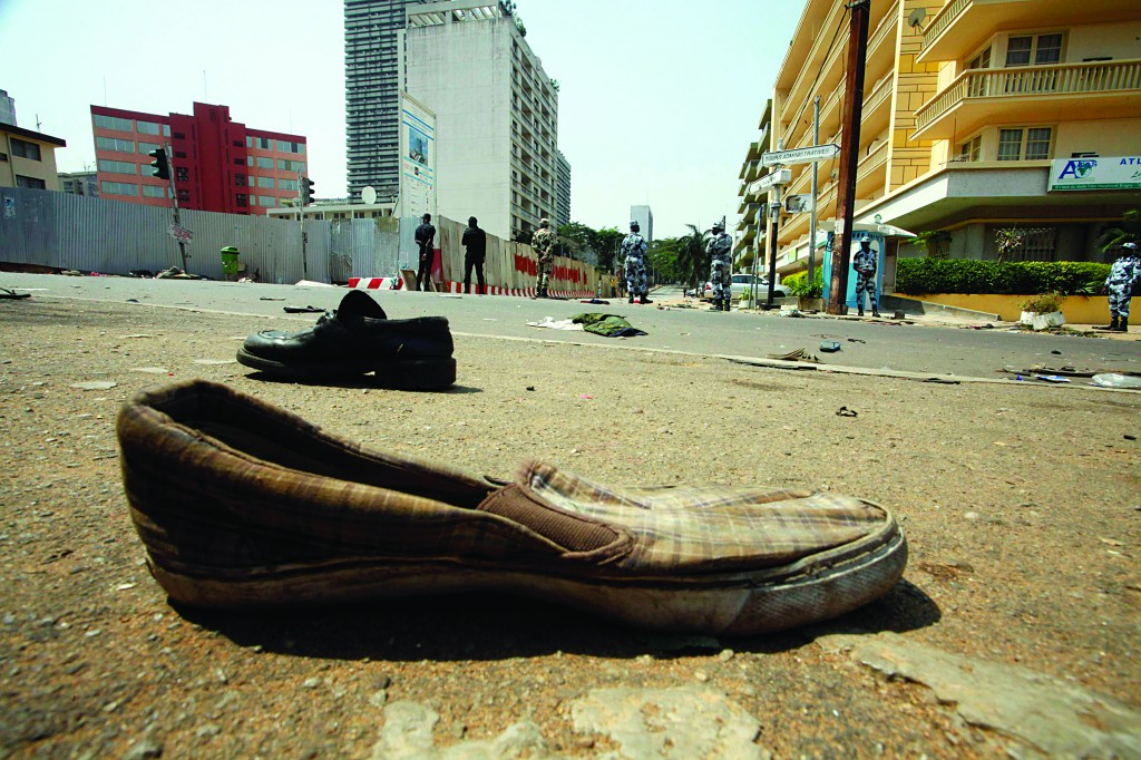 Shoes are seen along a street in Plateau district where a stampede occurred after a New Year's Eve fireworks display in Abidjan Tuesday. (REUTERS/Thierry Gouegnon)