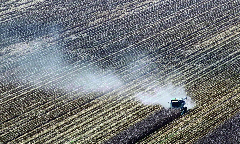In this Aug. 16, 2012 file photo, dust is carried by the wind behind a combine harvesting corn in a field near Coy, Ark. (AP Photo/Danny Johnston, File)