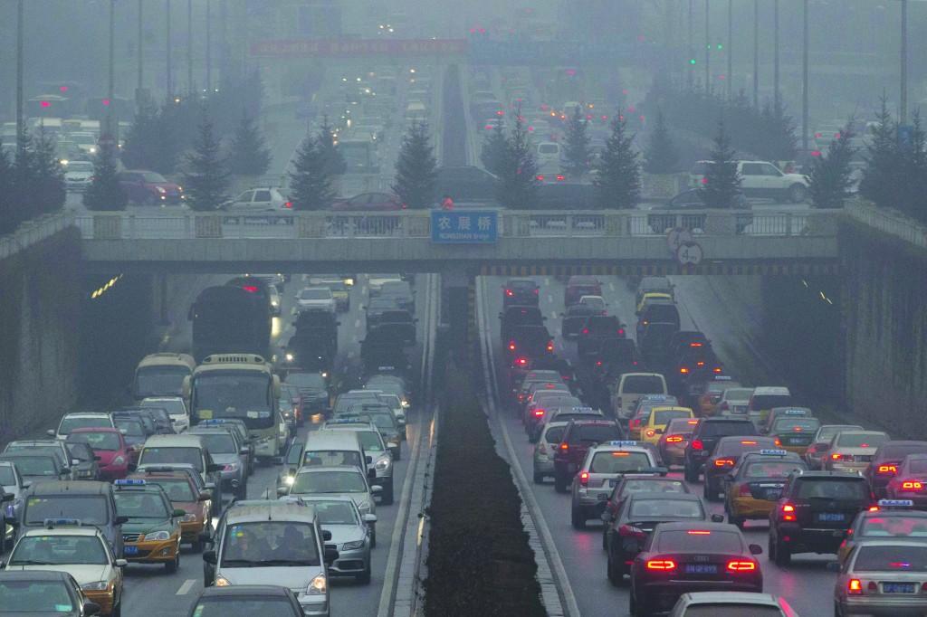 Vehicles crawl along a major road in Beijing, China, Thursday. (AP Photo/Ng Han Guan)