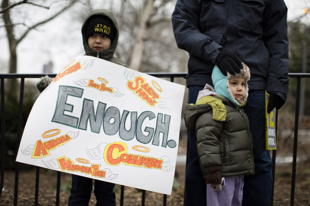 Dmitri Wild-Arons, 6, of Brooklyn, holds a sign listing several of the biggest mass shootings in United States history in Cadman Park before the One Million Moms for Gun Control Rally and march over the Brooklyn bridge, in New York. (AP Photo/John Minchillo)