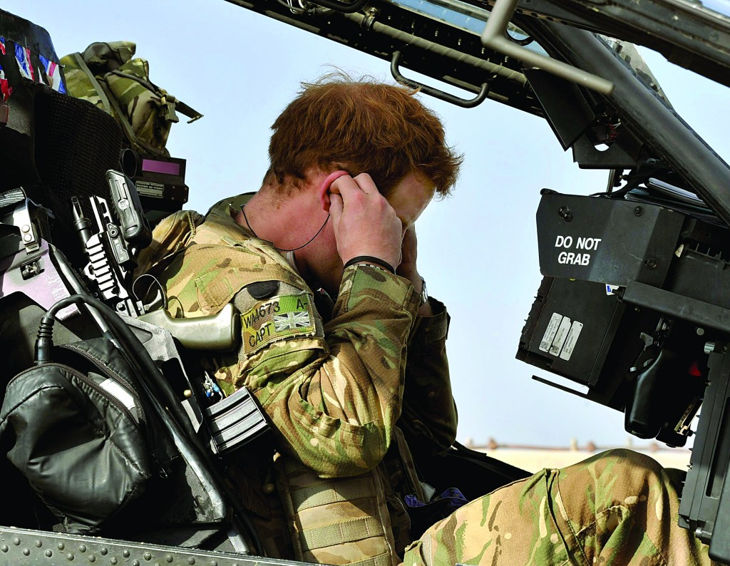Britain's Prince Harry sits in his cockpit as he prepares for a mission, at the British controlled flight-line in Camp Bastion, southern Afghanistan in this photograph taken October 31, 2012, and released January 22, 2013. (REUTERS/John Stillwell/Pool)