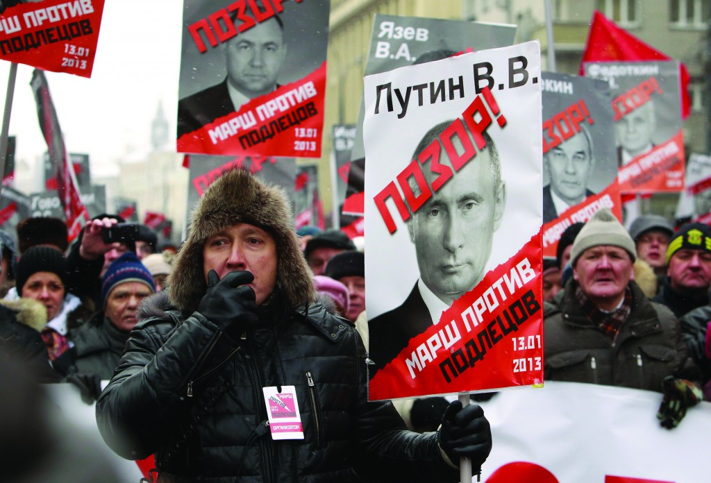 Opposition supporters take part in a protest march in Moscow, Sunday. (REUTERS/Sergei Karpukhin)