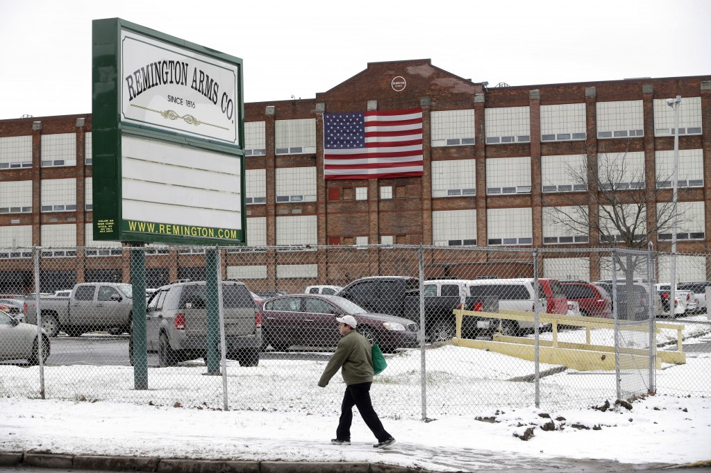 A man walks past the Remington Arms Company in Ilion, N.Y. (AP Photo/Mike Groll)