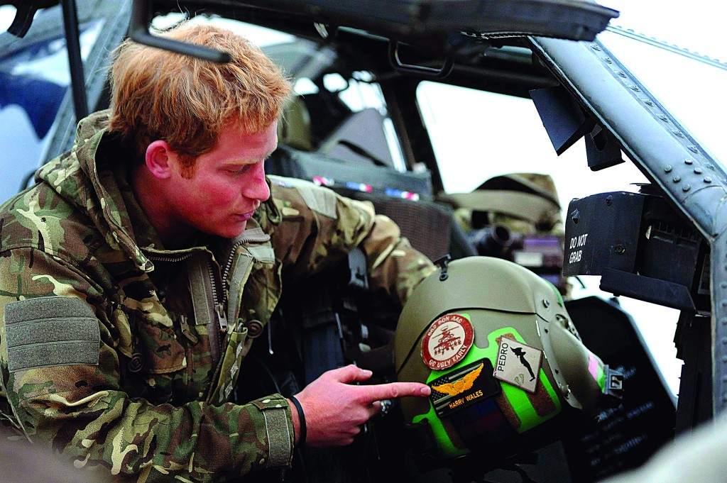 Britain's Prince Harry speaks during an interview with media at Camp Bastion, southern Afghanistan released January 21, 2013. (REUTERS/John Stillwell/Pool)