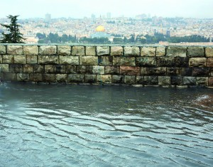 The Old City is seen in the background in a flooded area of Har Hazeisim on Monday. (FLASH90)
