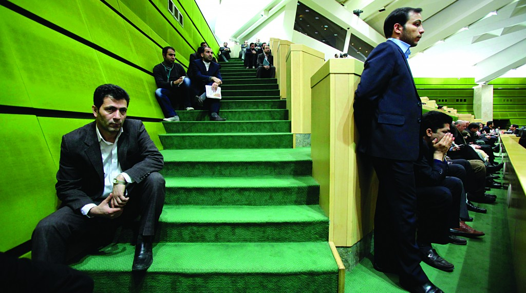 Iranian spectators follow President Mahmoud Ahmadinejad's speech at the parliament in Tehran. Iran's president says the country must move away from dependence on oil revenue to overcome Western sanctions that have slowed the economy and disrupted foreign trade. (AP Photo/Vahid Salemi)