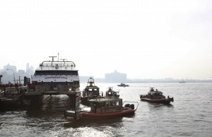 New York City emergency responders at the site of the commuter ferry crash yesterday. (REUTERS/Brendan McDermid)