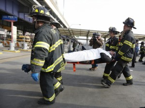 New York City Firemen carry a victim of a commuter ferry crash from the scene in New York. (REUTERS/Brendan McDermid)