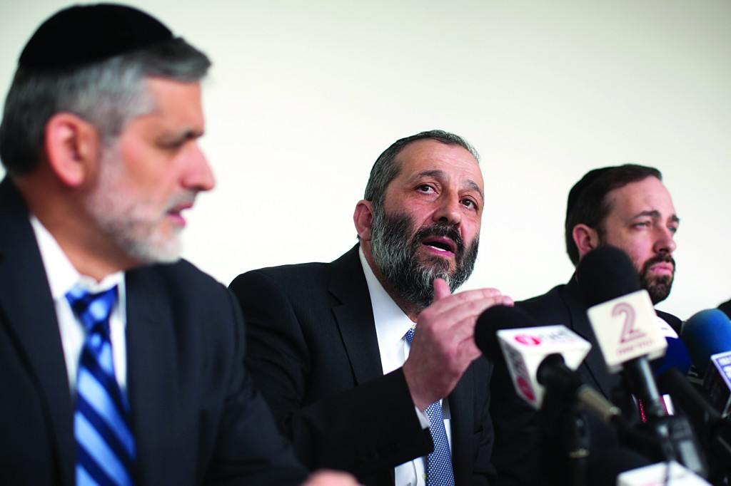 The Shas leadership: (R to L) Ariel Atias, Aryeh Deri and Eli Yishai at a party meeting on Sunday. (Flash90)