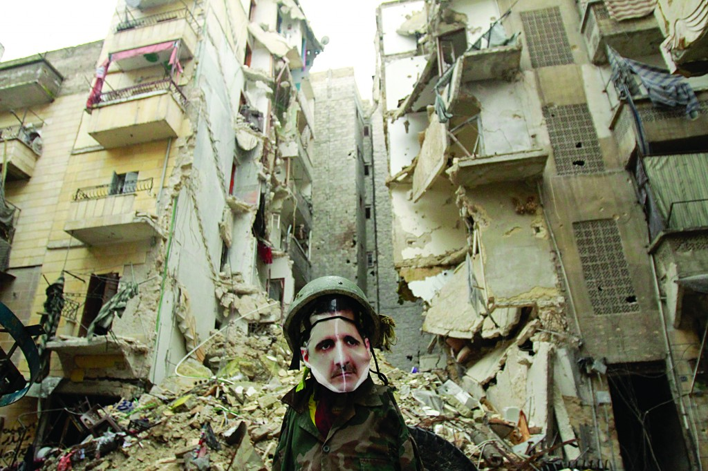 A dummy dressed up in army fatigues and a mask of Syrian President Bashar al-Assad's face is erected in the Salaheddine neighborhood of Aleppo, the scene of heavy fighting yesterday. (AFP/Getty Images)