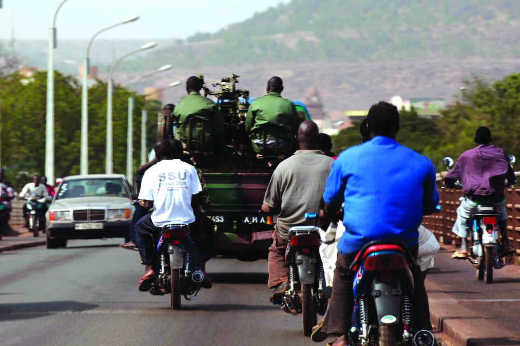 Malian soldiers drive on the streets of the capital, Bamako, January 12. (REUTERS/Joe Penny)