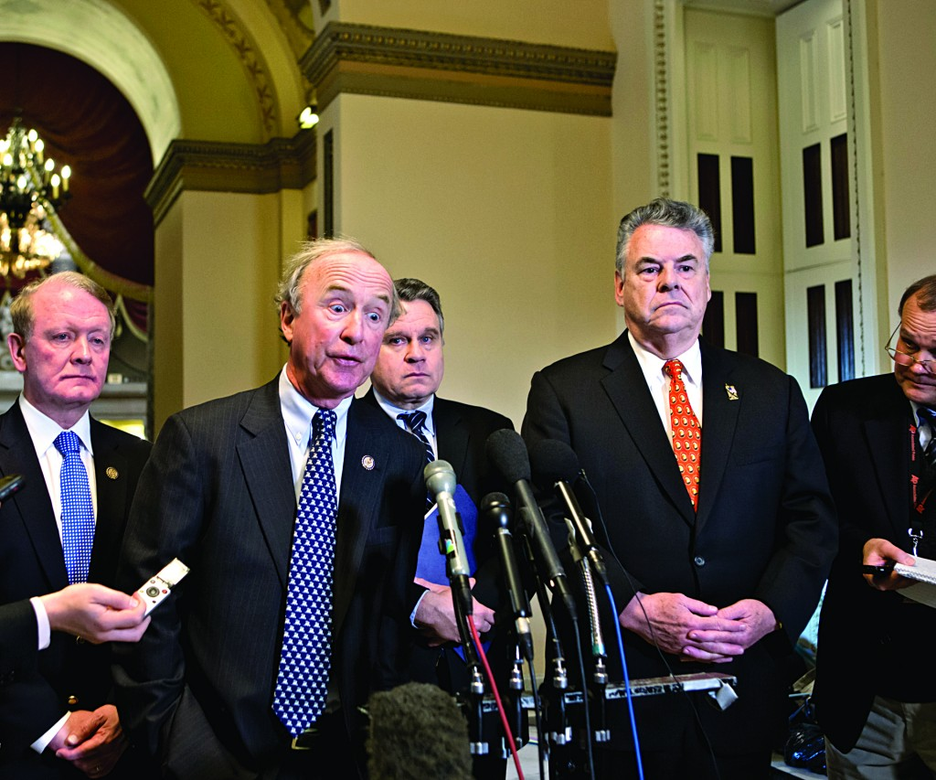 Republican Congressman Peter King (R-N.Y.) and other lawmakers speak to reporters after a meeting with House Speaker John Boehner (R-Ohio) over the delayed vote on aid for the victims of Superstorm Sandy, at the Capitol in Washington, Wednesday. (AP Photo/J. Scott Applewhite)