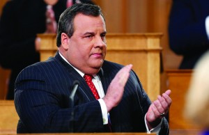 NJ Governor Chris Christie clapping while giving his State of the State address. (AP Photo)