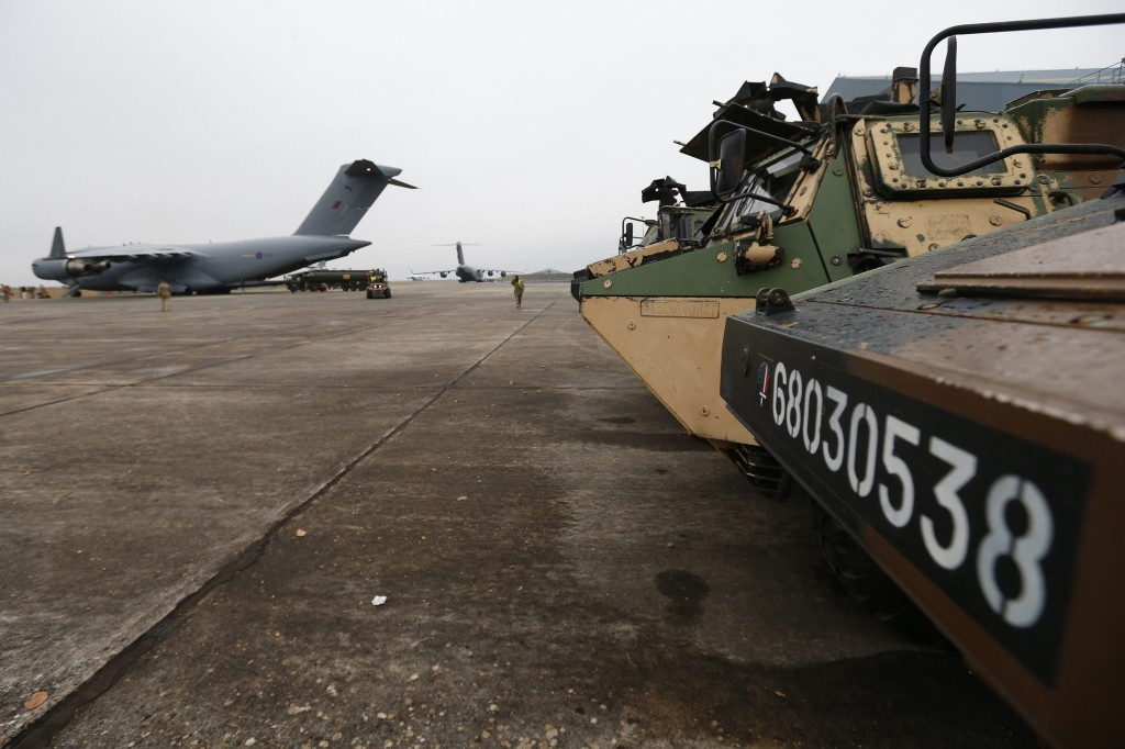 French military armored personnel carriers Monday wait to be loaded onto a Royal Air Force C-17 aircraft at Evreux in northern France. (REUTERS/Andrew Winning)