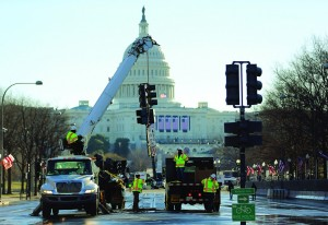 Workers from M.C. Dean Company remove the street lights along Pennsylvania Ave as they prepare for the Inauguration Parade on Sunday in Washington, DC. (Joe Raedle/Getty Images)