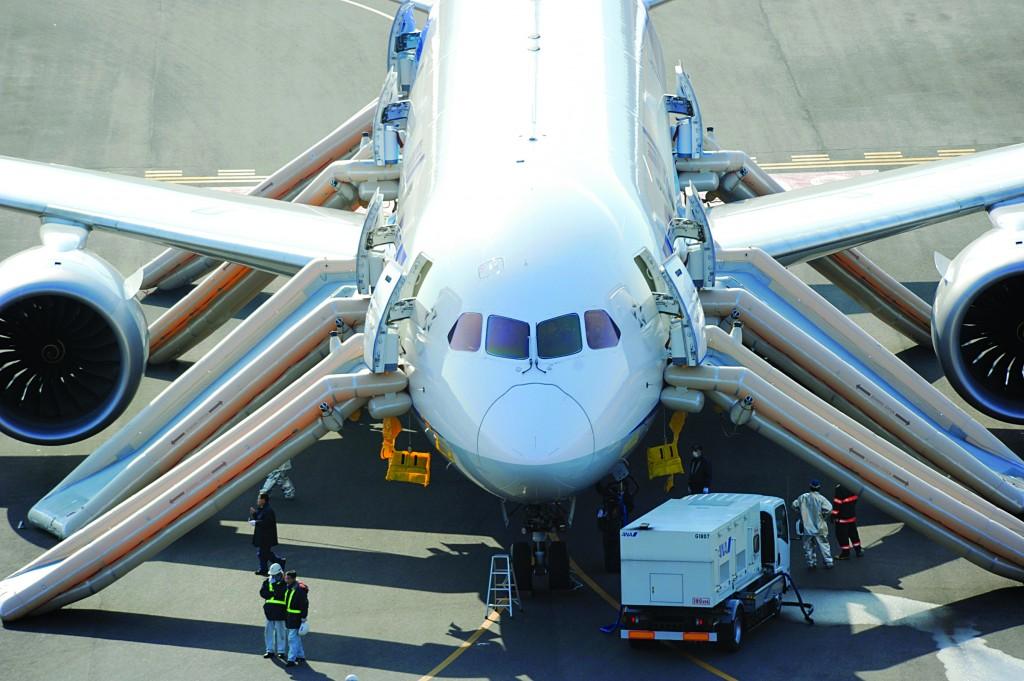 An All Nippon Airways flight sits at Takamatsu airport in Takamatsu, western Japan after it made an emergency landing and passengers evacuated from the plane on Wednesday. (AP Photo/Asahi Shimbun, Noboru Tomura)