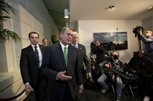 Late on Jan. 1, Speaker of the House John Boehner (R-Ohio), and House Ways and Means Committee Chairman Dave Camp (R-Mich.), center rear, walk past reporters after a closed-door meeting meeting of House Republicans. (AP Photo/J. Scott Applewhite)