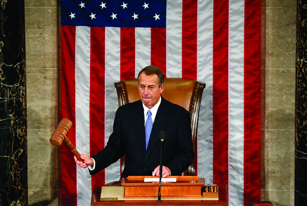 Speaker of the House John Boehner bangs the gavel during the first day of the 113th Congress at the Capitol in Washington, Thursday. Boehner won re-election as speaker of the House of Representatives and will lead Republicans as they take on the White House over federal spending. (REUTERS/Kevin Lamarque)
