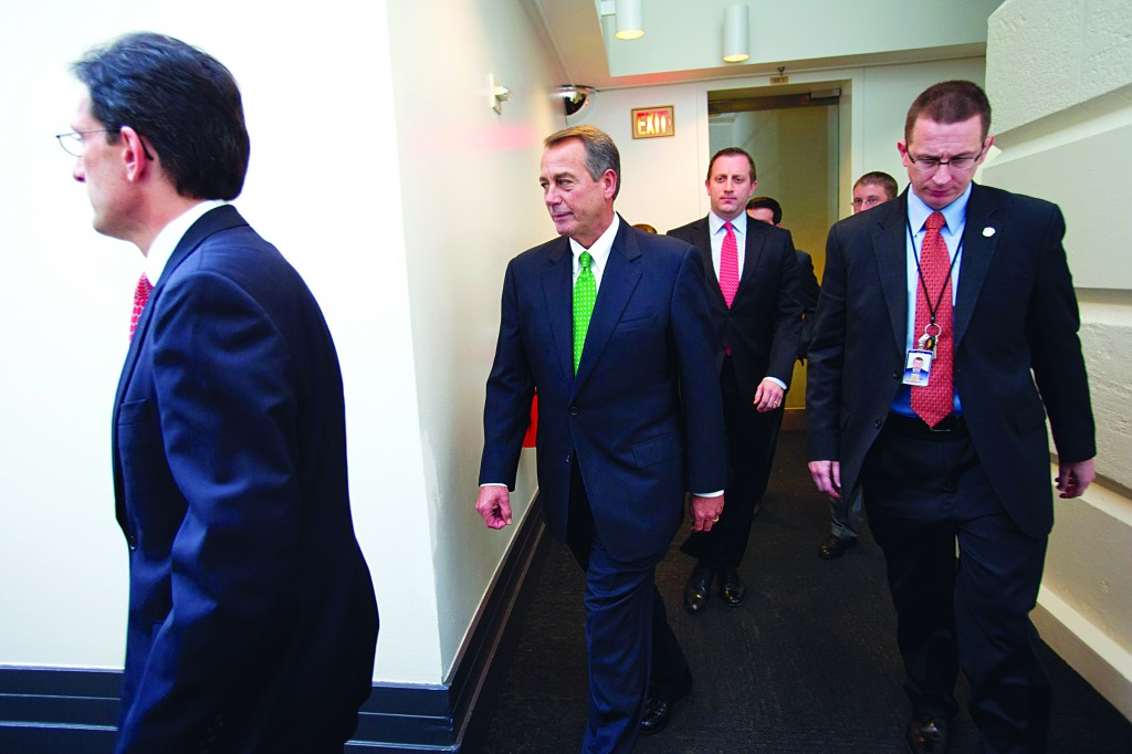 House Majority Leader Eric Cantor of Va. (L); House Speaker John Boehner of Ohio (C) and others arrive for a Republican caucus meeting on Capitol Hill in Washington, Tuesday. (AP Photo/Jacquelyn Martin)