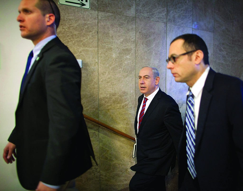 Israel's Prime Minister Binyamin Netanyahu (C) arrives for the weekly Cabinet meeting in Yerushalayim on Sunday. (REUTERS)
