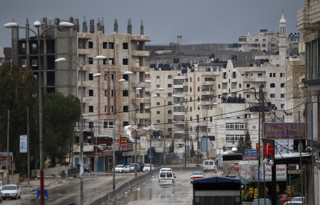 A general view of the Kufr Aqab Yerushalayim neighborhood, one of several Arab areas separated from the municipality by the security barrier. (AP Photo)