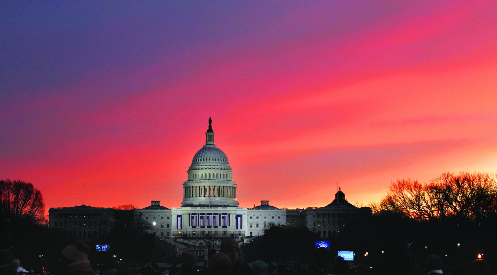 The sun rises over Capitol Hill looking down Pennsylvania Avenue in Washington on Monday as Washington prepared for the 57th Presidential Inauguration. (AP Photo/Alex Brandon)