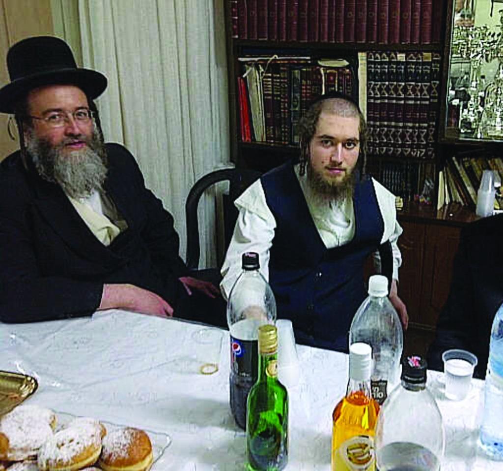 Yaakov Yosef Grunwald (R) sits next to his father, Rabbi Moshe Yitzchok Grunwald, two weeks ago during his prison furlough.