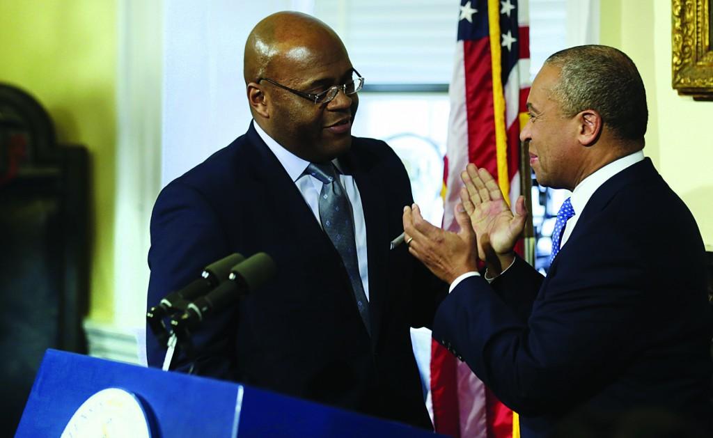 "William ""Mo"" Cowan (L) with Mass. Gov. Deval Patrick during a news conference where he was named interim U.S. Senator. (AP Photo/Charles Krupa)"