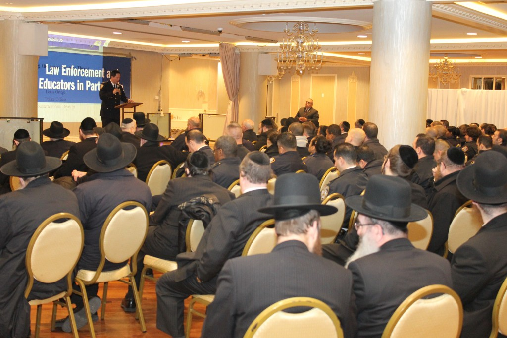 Chief Thomas Chan, commanding officer of the Brooklyn South police, speaks at the Misaskim event Wednesday in Bais Sura.