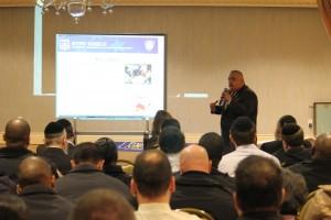 Inspector Luis Ortega of the NYPD counterterrorism division speaks at the Misaskim event Wednesday in Bais Sura school.