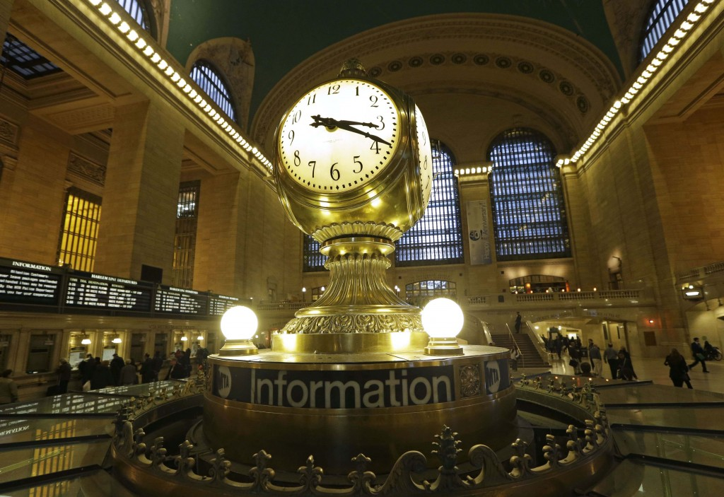The famous opalescent clock keeps time at the center of the main concourse in Grand Central Terminal is shown in New York. (AP Photo/Kathy Willens)