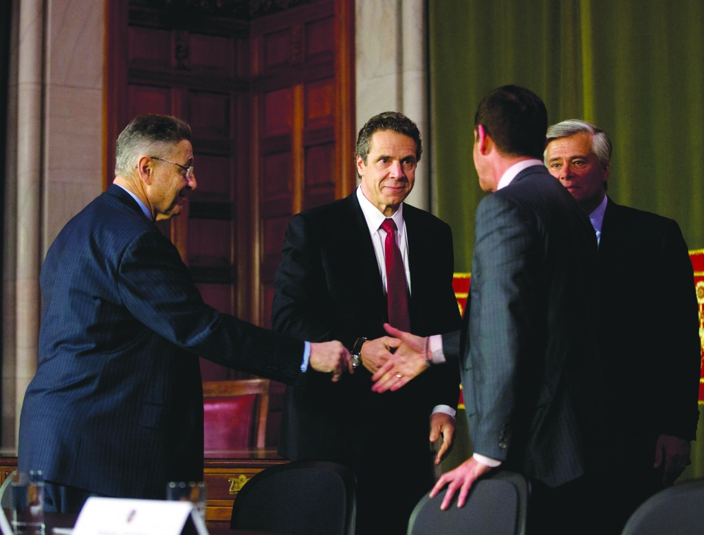 Assembly Speaker Sheldon Silver (D-Manhattan) (L), Gov. Andrew Cuomo (C), Senate Majority Leader Dean Skelos (R-Rockville Centre) (R) and Senate co-leader Jeff Klein (D-Bronx) (back to camera), shake hands after a news conference in the Red Room at the Capitol on Wednesday, in Albany, N.Y. (AP Photo/Mike Groll)