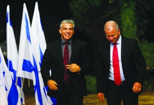 Yair Lapid (L), leader of the Yesh Atid party, is escorted by an employee of the President's office before meeting Israel's President Shimon Peres (unseen) on Wednesday for consultations over the formation of a new coalition. (REUTERS)