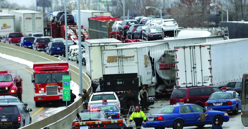A section of multi-vehicle accident on Interstate 75 is shown in Detroit, Thursday. Snow squalls and slippery roads led to a series of accidents that left at least three people dead and 20 injured on a mile-long stretch of southbound I-75. More than two dozen vehicles, including tractor-trailers, were involved in the pileups. (AP Photo/Paul Sancya)