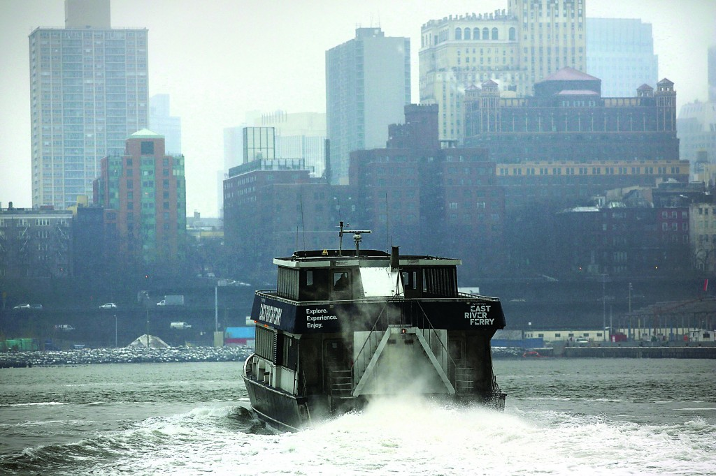 A ferry boat traverses the East River as it snows during the morning commute on Monday, in New York City. Following some of the coldest weather this winter, temperatures are expected to gradually warm during the week in New York. (Spencer Platt/Getty Images)