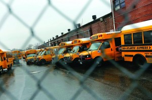 School buses are seen parked behind a locked bus depot fence in Queens, New York, Wednesday. (REUTERS/Shannon Stapleton)